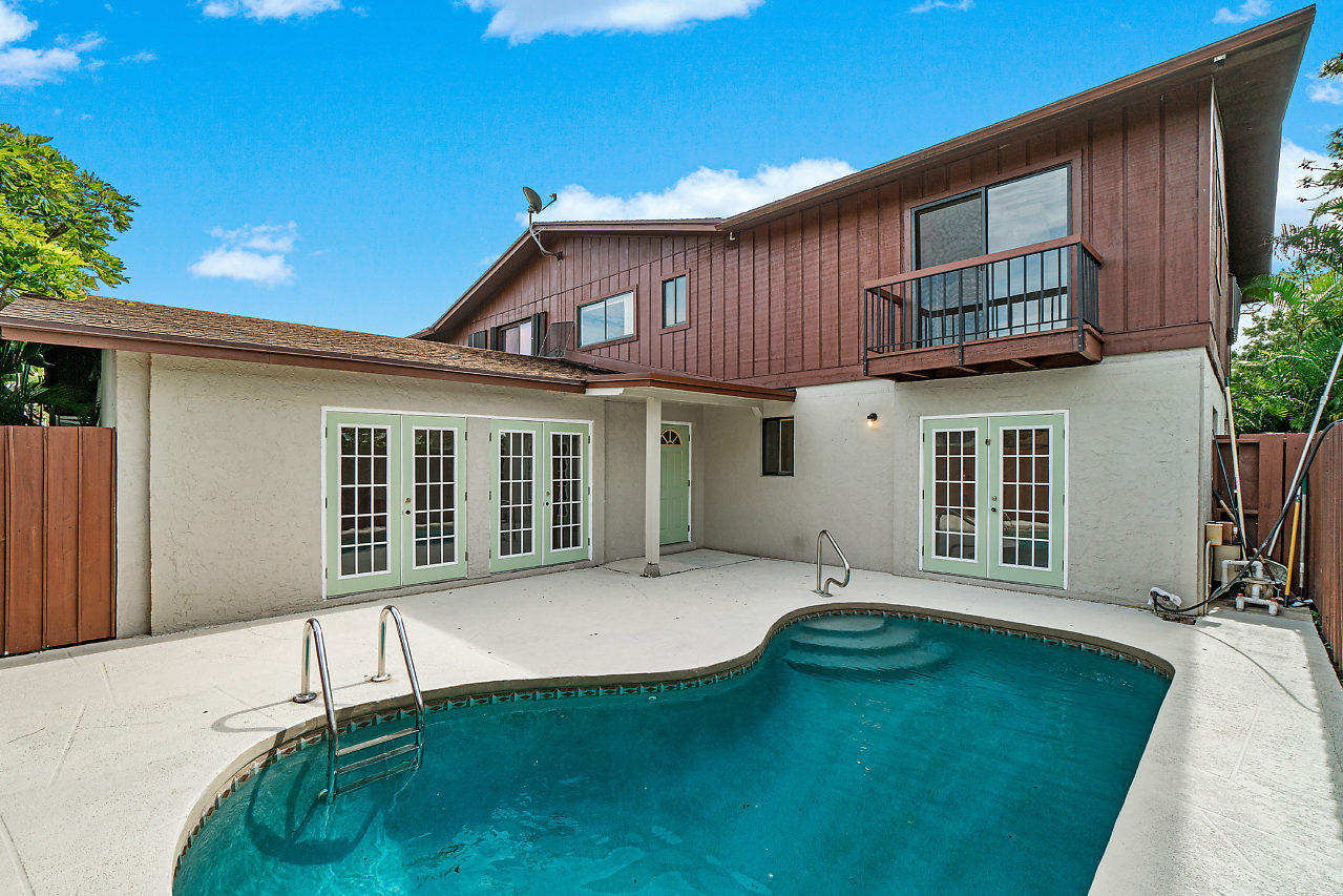 Rare find! 3 bedroom 2 bath spacious townhome with a beautiful pool. Plenty of room for entertaining with fenced in private deck, updated kitchen and appliances, new wood tile flooring upstairs. Brand New water heater and newer A/C. Master bedroom downstairs with 2 closets including a decent size walk in and bathroom with a perfect view of the pool. Additional 2 bedrooms/1 bath upstairs with a small open den area perfect for a desk/office use. Townhome is located in a private corner within community featuring vaulted ceilings and plenty of light in this quiet neighborhood.