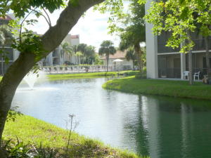 Beautiful water view from this garden floor unit. Relax and enjoy the serenity from your screened patio.