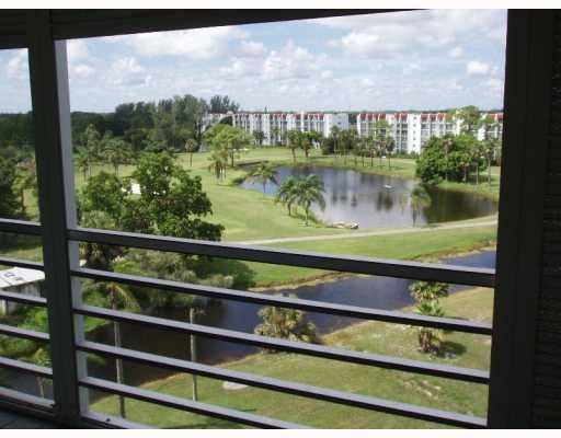 THIS POPULAR AMBASSADOR CONDO HAS WIDE & DEEP WATER & GOLF VIEWS & A BALCONY THAT OPENS INTO THE EAT-IN KITCHEN, LIVING ROOM & MASTER BEDROOM.  THIS BRIGHT, FRESHLY PAINTED CONDO FEATURES UPDATED KITCHEN CABINETRY, GRANITE COUNTERTOPS AND  NEW CARPETING IN THE BEDROOMS & LIVING ROOM.  THERE IS ALSO IMPACT WINDOWS THROUGHOUT EXCEPT FOR THE SLIDERS THAT ARE PROTECTED WITH ACCORDION HURRICANE SHUTTERS ACROSS THE BALCONY. THIS PRISTINE CONDO IS AVAILABLE FULLY FURNISHED. THERE IS A POOL AT THE BUILDING & THE CLUBHOUSE IS NEXT DOOR WITH ITS ADDITIONAL POOL, TENNIS, PAY-AS-YOU-PLAY GOLF, MEL'S BISTRO RESTAURANT & ENTERTAINMENT, GYM, MOVIES, SHOWS, TRIPS, CLASSES,CLUBS, LIBRARY, BILLIARDS & MORE!  MAKE THE MOVE AND THIS ONE IS EASY!+++SERVICE CONTRACT ON AC,PLUMBING +APPLIANCES AVAILABLE+++