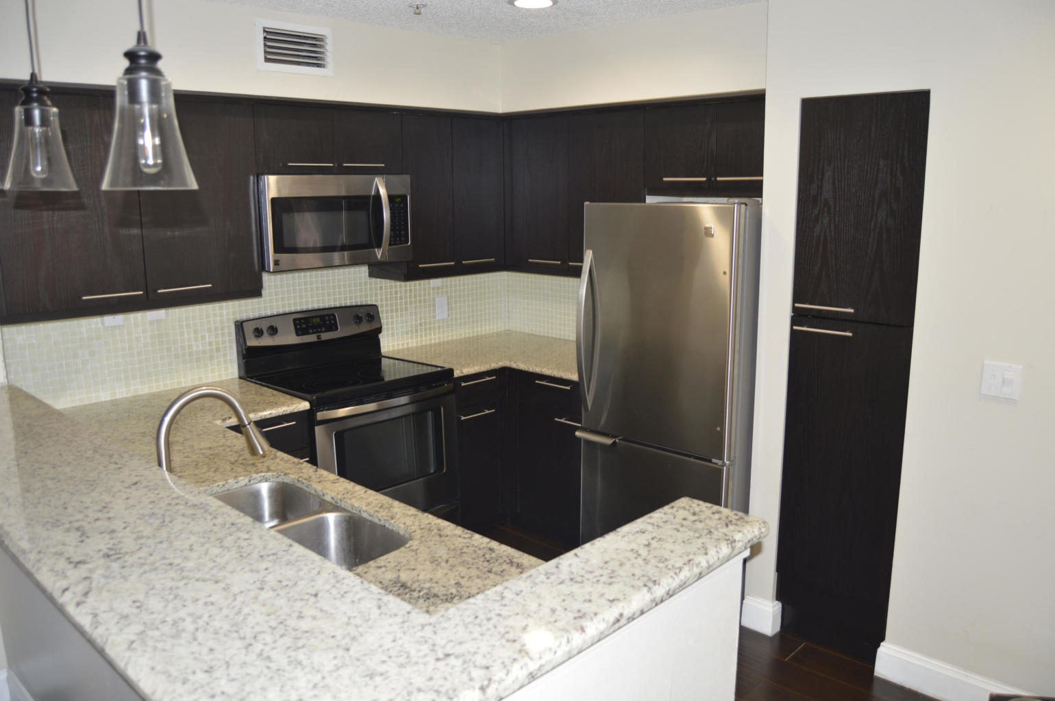 It is rare to find a bright, spacious and upgraded condo in a gated community with such an amazing school district for this price! Come see this condo before it is too late, and you end up in your bedroom, crying over it. It is close to schools, malls, shopping, hospitals, beaches, restaurants and much, much more. Call to see it today!! :)