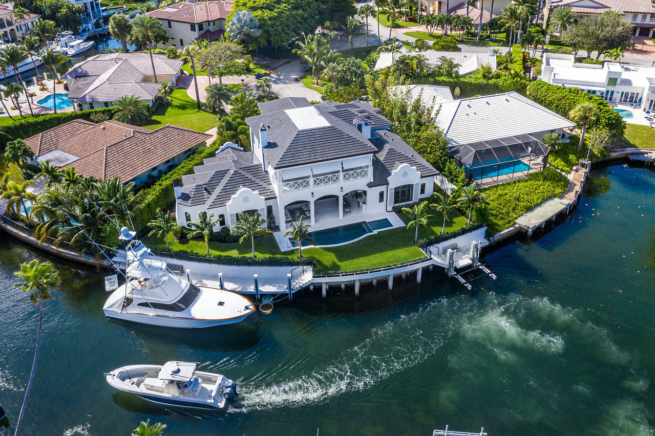 Imagine yourself living in this immaculate 137' point lot estate in quintessential Boca Raton seaside enclave, Sun & Surf. Two fully equipped docks accommodate a 70' vessel & a 40' boat on Neptune elevator lift. Unmatched view on wide crystal clear turning basin - you're certain to spot sea turtles. Completed in 11/2017, no expense was spared, no detail overlooked in the residence. Designer finishes include Walker Zanger tile, RH and Newport Brass fixtures and a true gourmet kitchen. Private entrance guest suite, sequestered master, and all en-suite bedrooms. Full CBS construction, poured concrete second floor, best-in-class CGI impact windows, entire loggia opens via Euro-Wall accordion impact windows onto summer kitchen and outdoor living are enclosed with concealed electric screen.