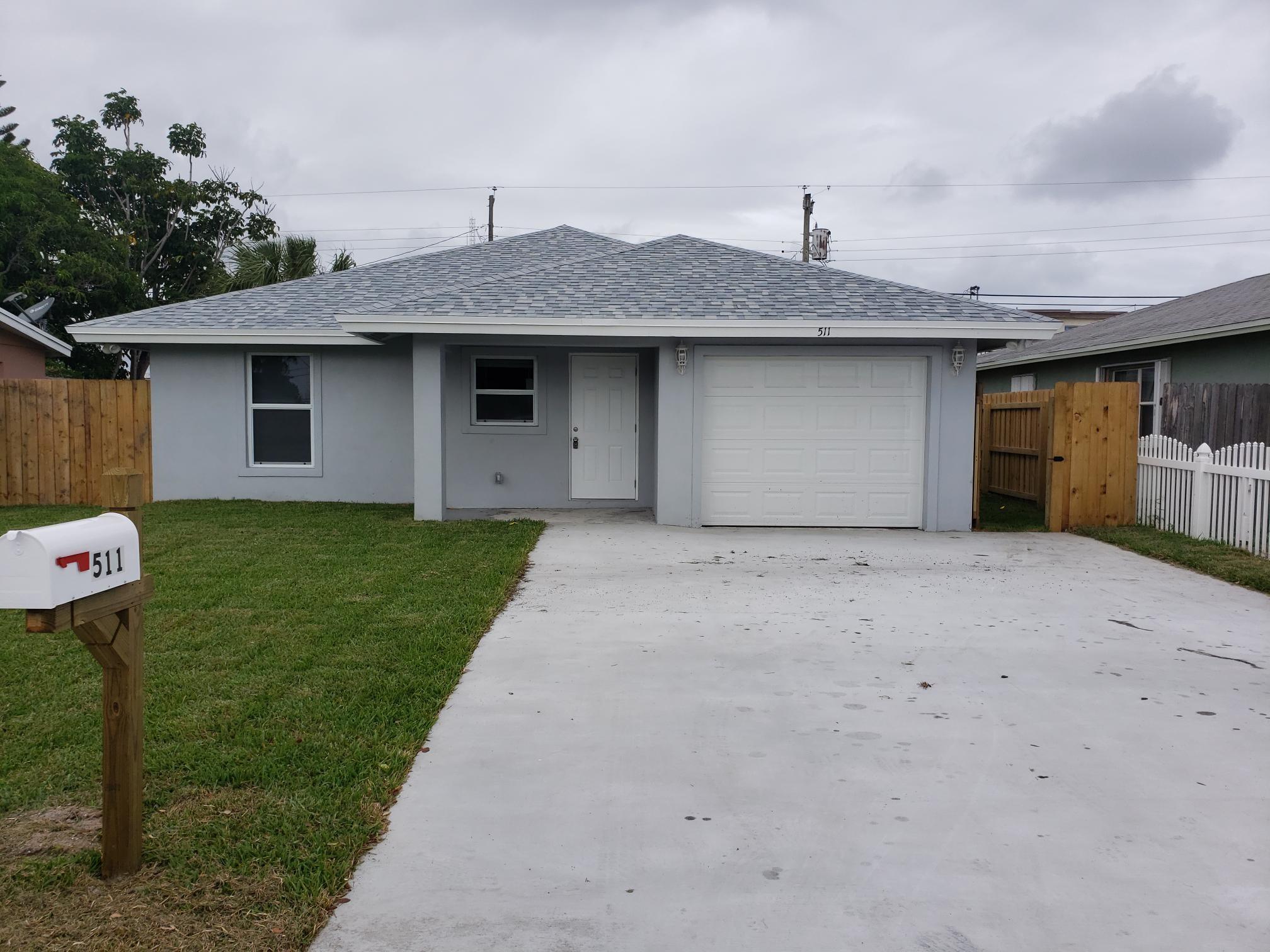 New 2019 construction 3 bedroom/ 2 bath home in the heart of Boynton Beach, FL with convenient access to I-95, shopping districts and waterfront. Features fenced rear yard, hurricane impact windows, impact exterior and garage doors, custom soft-close kitchen cabinetry with upgraded Quartz surface top, stainless appliances, simulated wood tile floor throughout home, recessed lighting in interior common areas, solar attic vent fan for energy efficiency, upgraded Quartz vanity tops and custom tile shower niches in both bathrooms, dimensional asphalt shingle roof, new 2.5 ton AC system, 150 Amp electric service panel and auto irrigation sprinkler system. Ask about our WARRANTY.