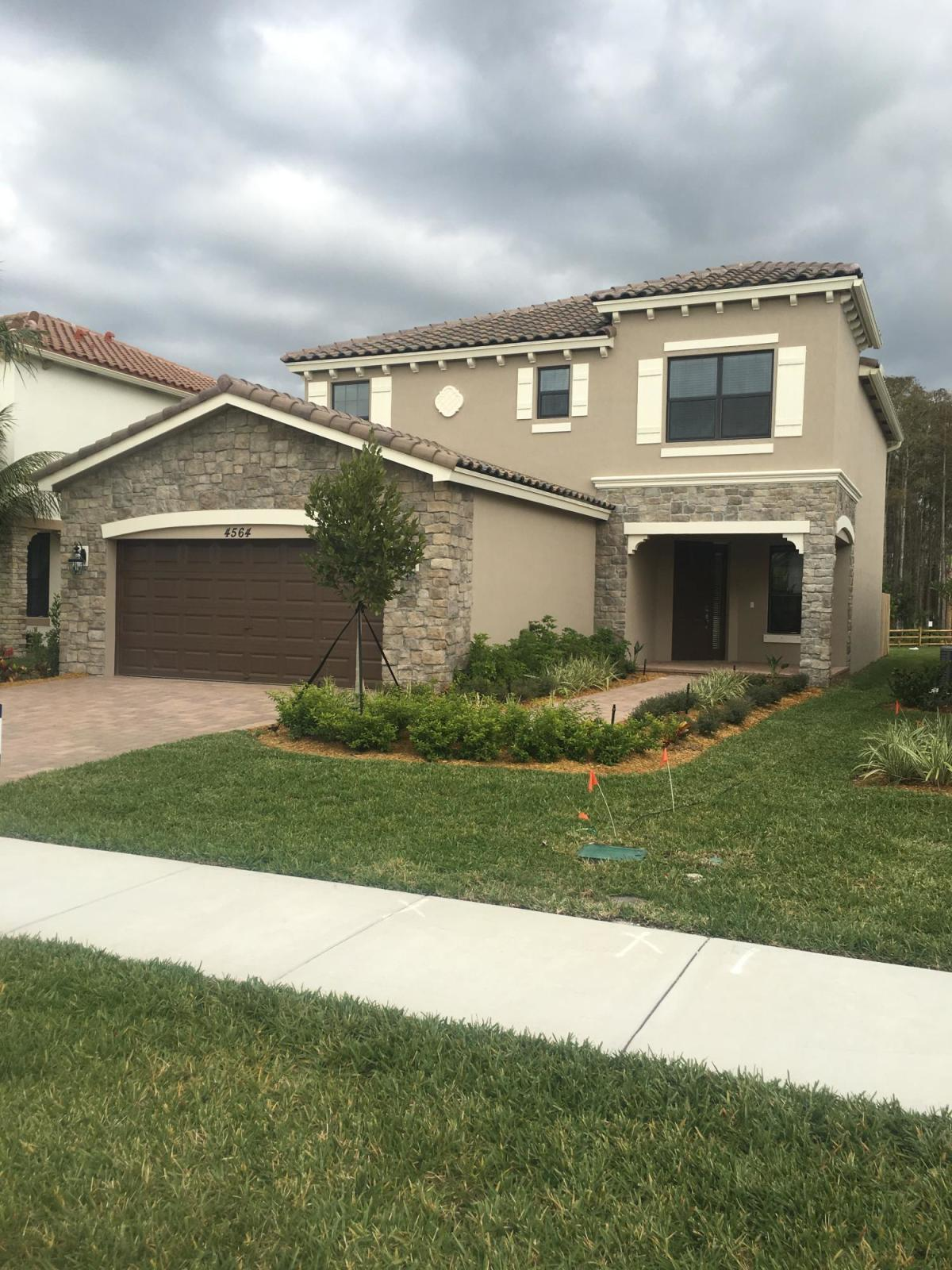 Beautiful large family home in most desireable Lake Worth.  Don't miss opportunity to own this newly built 5 bedroom 3 bath open floor plan home. Separate living room, family room, granite countertops, stainless steel appliances, impact windows, oversized master bedroom.  Huge backyard, 2 car garage. Hurry before it's gone.