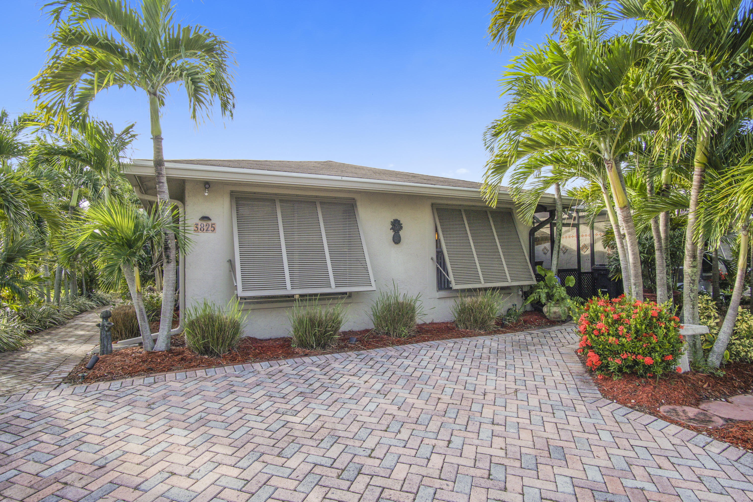 A True Florida Style Home. This home is a tropical oasis located in West Lake Worth and features 2 bedrooms/2baths, a main living room area and a large spacious Florida-bonus room with wrap around windows. This home features front and back screened Lanais, Plantation shutters, a wide-brick-paver driveway, spacious storage room and lush landscaping. Bright Eat-In kitchen with stainless steel appliances and lot of cabinets for storage. This home also features a bar and a dining room area thtat flows right into the kitchen. Low HOA, serene lakes throughout neighborhood. Clubhouse pool, gym, and lots of amenities. Just a few minutes from the turnpike and walking distance from shopping center and restaurants. You don.t want to mis this one!