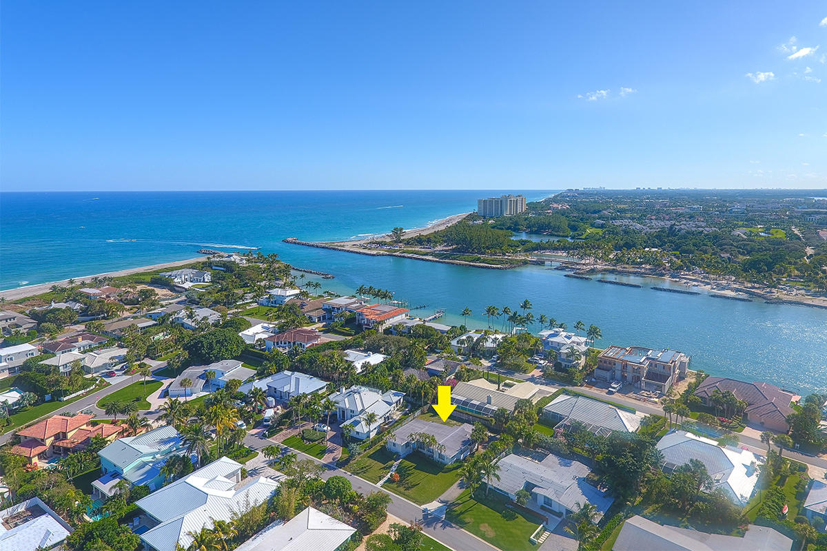 Live in paradise. Charming 3 bedroom, 2 bath beach home or build your dream home on this spacious lot in this desirable beach side community of Jupiter Inlet Colony. Community offers beach access with stunning turquoise, clear ocean waters. This neighborhood is a playground for snorkeling, paddle boarding, fishing and more. Jupiter Inlet Colony is surrounded by the Atlantic Ocean, Intracoastal waters and Jupiter Inlet. Dogs are allowed on the beach with leash. Community is considered its own town with private police department within for the 243 home sites. JIB Club Marina with boat slips and beach club available for additional fees and/or membership required.