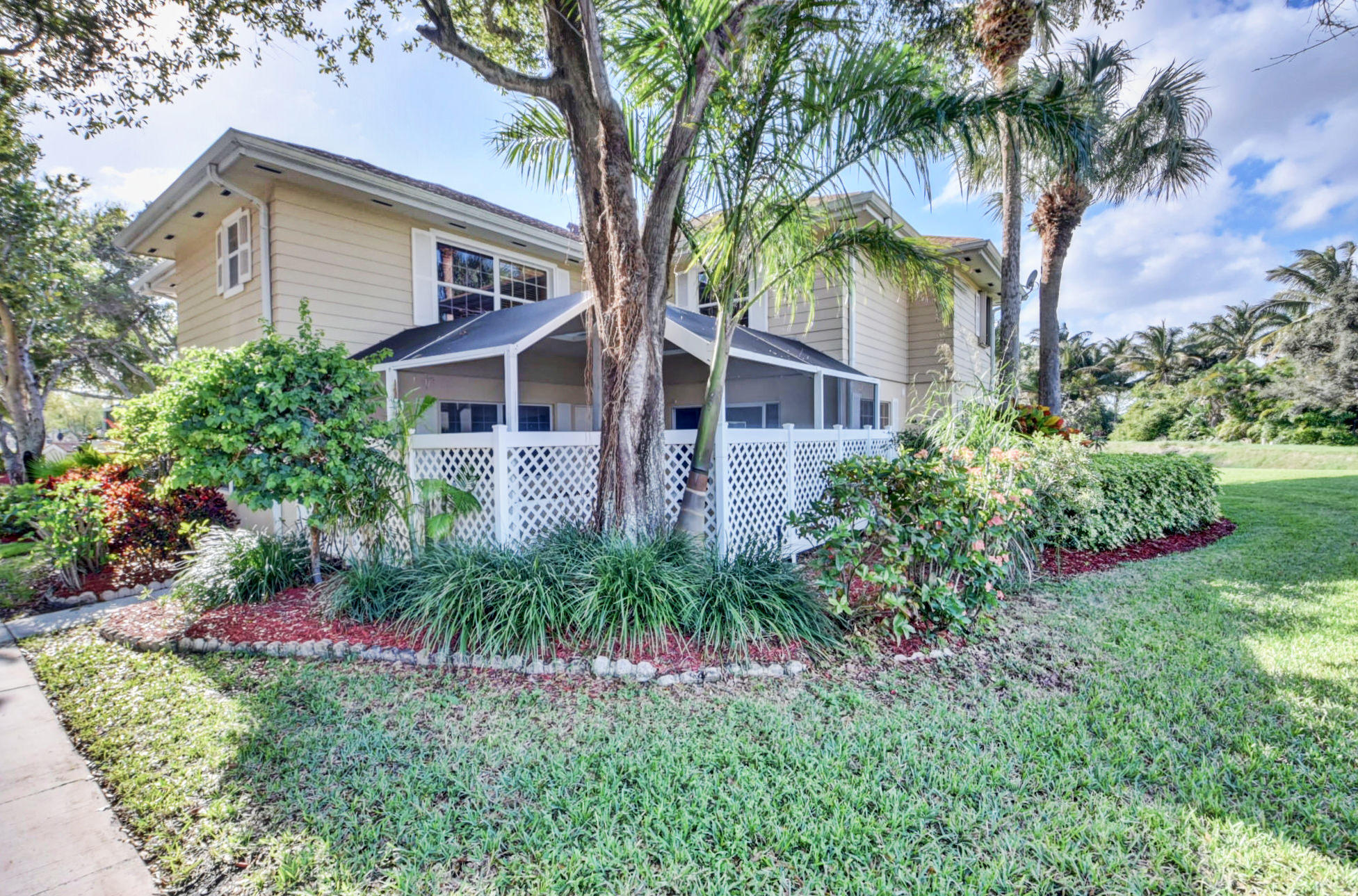 Spacious and private townhome property set in the back of the lovely Wellesley community. Located close to all of central Boynton Beach's best dining and shopping options, easy access to I95 and great schools. This unit offers the most privacy within the community, adjacent to the canal and on the back of the building. Pass through the gate into a 336 square foot, screened-in, covered patio. Amazing space to entertain! Entrance into the living room which features great natural light and laminate floors. Open kitchen/dining room is great for entertaining and features large sliding glass door and double window. Downstairs half bath, laundry and oversized storage closet.Two spacious master-suites upstairs with plenty of room for king-size beds.This home is ready for its new ow