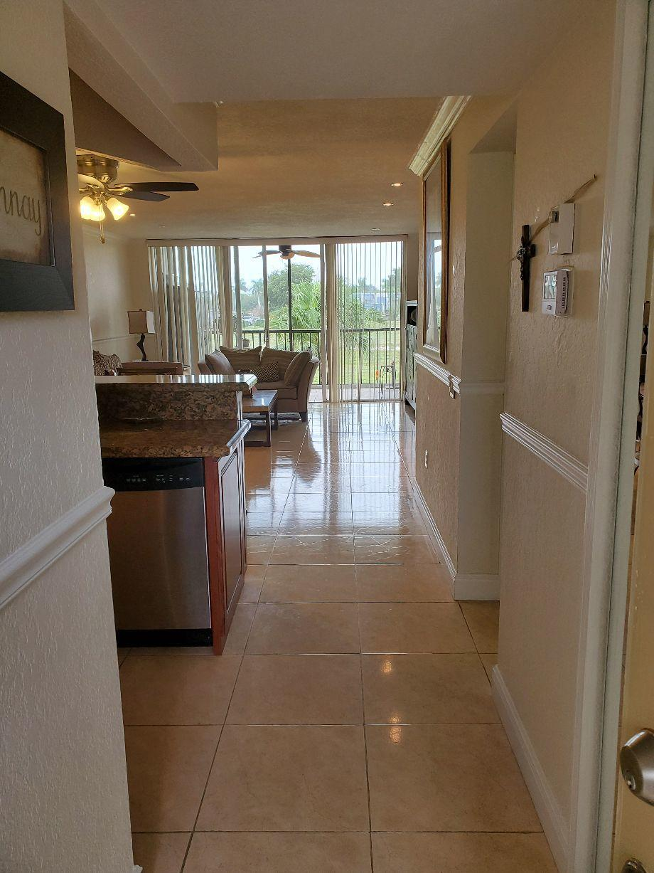 Updated condo includes Granite, Crown Molder, Texture walls & celings, both bathrooms and Kitchen upgraded.  New A/C 6 months old, New Electrical Panel 6 months old, Hurricane Shutters on Patio Screen.  Pets allowed with restrictions.***No Membership Fees are mandatory.***  Fountains clubhouse etc, not included unless you buy the membership.Community Pool is close.  Community has 24 hour Security.  Paths for biking and walking.Includes Water, Cable, Wifi & Building Insurance.  Common Laundry on First Floor - New