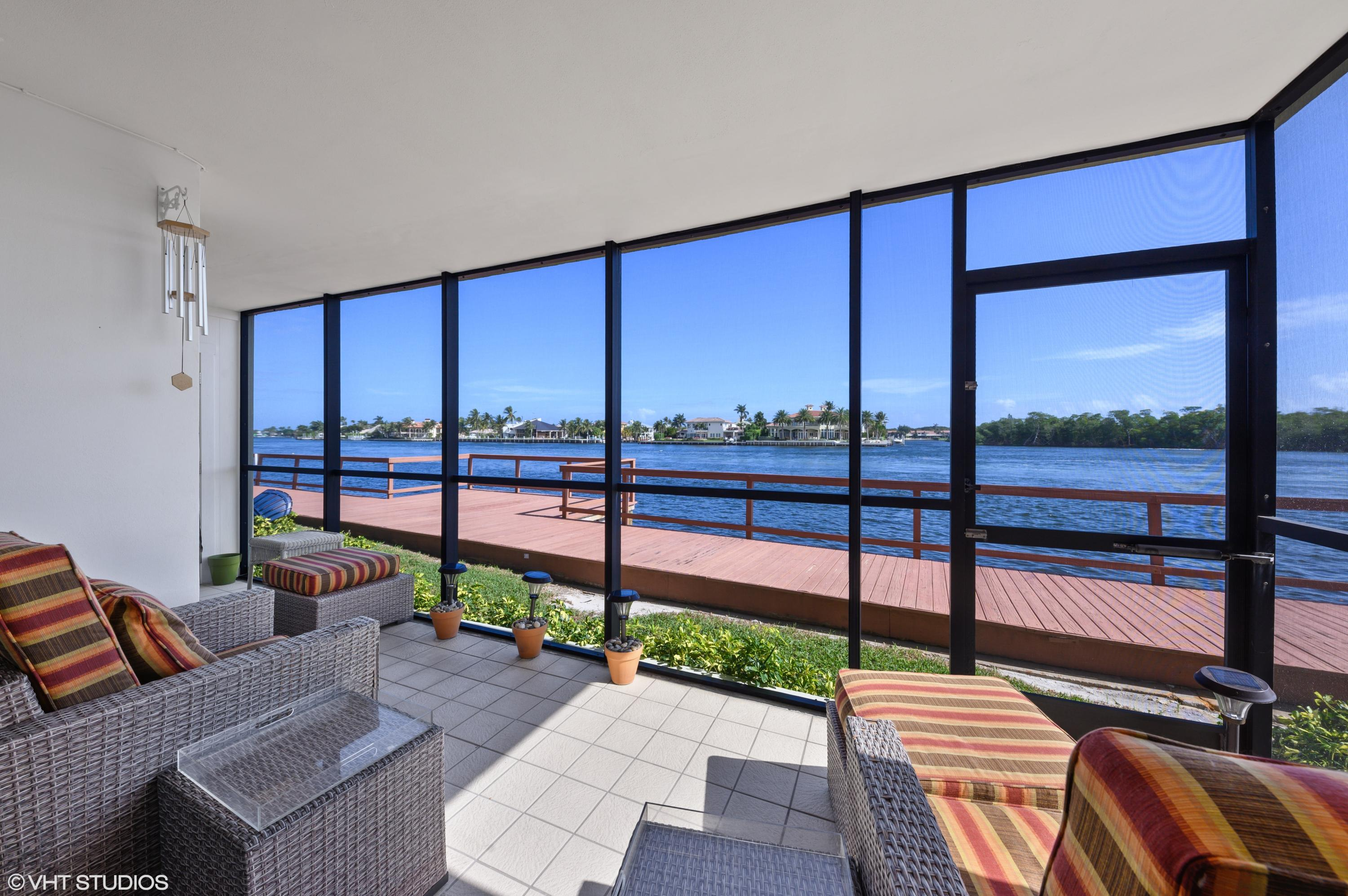 Be the envy of your friends while enjoying the easterly breezes and marine activity in this direct Intracoastal condo.   Waterviews the moment you walk in.   This renovated 2/2  condo boasts of quartz kitchen countertops, glass tiled backsplash, self-closing cabinets, and drawers.  Wood-look porcelain tiles throughout, plantation shutters, and impact windows.  The expansive screened-in lanai has tiled flooring, storage closet, accordion hurricane shutters, and no obstructing views.  This boutique, waterfront building has only 28 units. The low maintenance fee of $975.00, paid quarterly, includes water, sewer, and basic cable.   Seawall work, painting and parking lot have been completed. Close to the beach, shops, dining, highways, and airports.  Million-dollar views without the million $$$