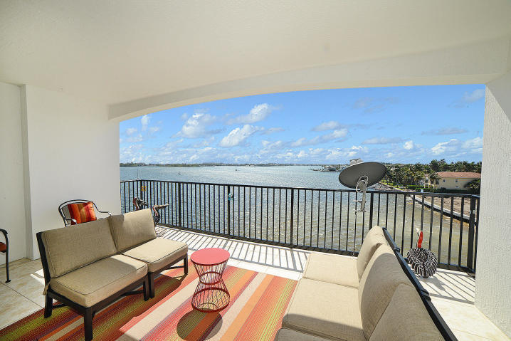 Enjoy this one of a kind Penthouse unit with amazing Intracoastal, sunrise and sunset views from your 300 Sq Ft covered balcony. This oversized 2 bedroom waterfront condo has natural daylight coming in throughout the day as well as stainless steel appliances, new laminate floors, and custom California King closet built ins in each of the closets. This unit comes with an interior covered parking spot. Also includes a large storage room within the unit itself. Also, Includes automatic security system and camera. Private gated community, covered parking, Pet-friendly community, Clubhouse with cyber cafA(c), Media room with large flat screen TV, Full-circuit Fitness center with 24-hour access, Heated resort-style pool and whirlpool at the water's edge, WiFi throughout clubhouse and pool