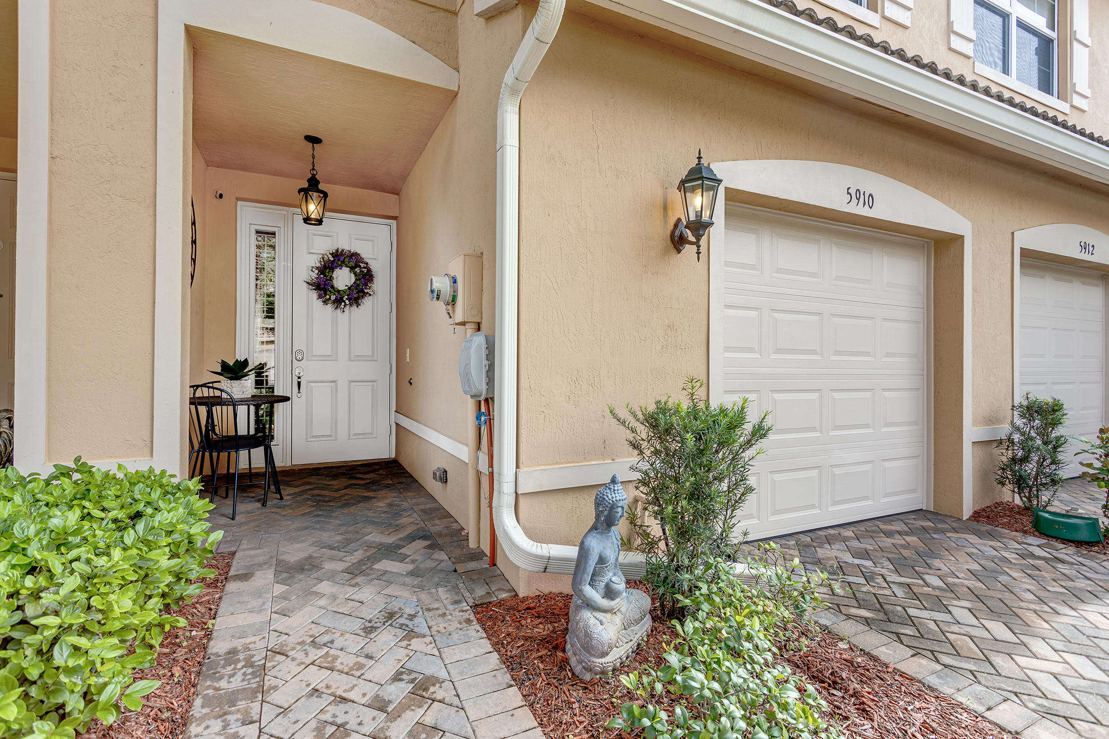 ASOLUTELY STUNNING AND BETTER THAN NEW! You will be wowed when you walk in to this 3 Bed 2.1 Bath townhome. This 2016 built home has serious high-end upgrades & customized options to make it look like a model home including New high-end flooring, Plantation Shutters on every window on both levels, granite counters & backsplash, high-end white 42'' inch cabinets, stainless steel appliances, extra recessed lighting, and crown molding throughout the home including bedrooms, ceiling fans in all the rooms. Full washer & dryer on the 2nd level. One of the only homes with brick paved and hurricane rated screen enclosure, perfect for entertaining and weekend BBQ's.This home has been meticulously cared for and truly a MUST SEE! You will not be disappointed!! Community also boasts a lakefront club.. Life-Fitness professionally-equipped gym, card room, great room and warming kitchen to host those special private events, lakefront heated swimming pool and spa for that resort feel, tot-lot, basketball court, lakefront walking paths with gazebos, benches, lush landscaping and tranquil lake with beautiful sunset views. This amenity-rich community also features a floating dock on the lake with paddle boats!