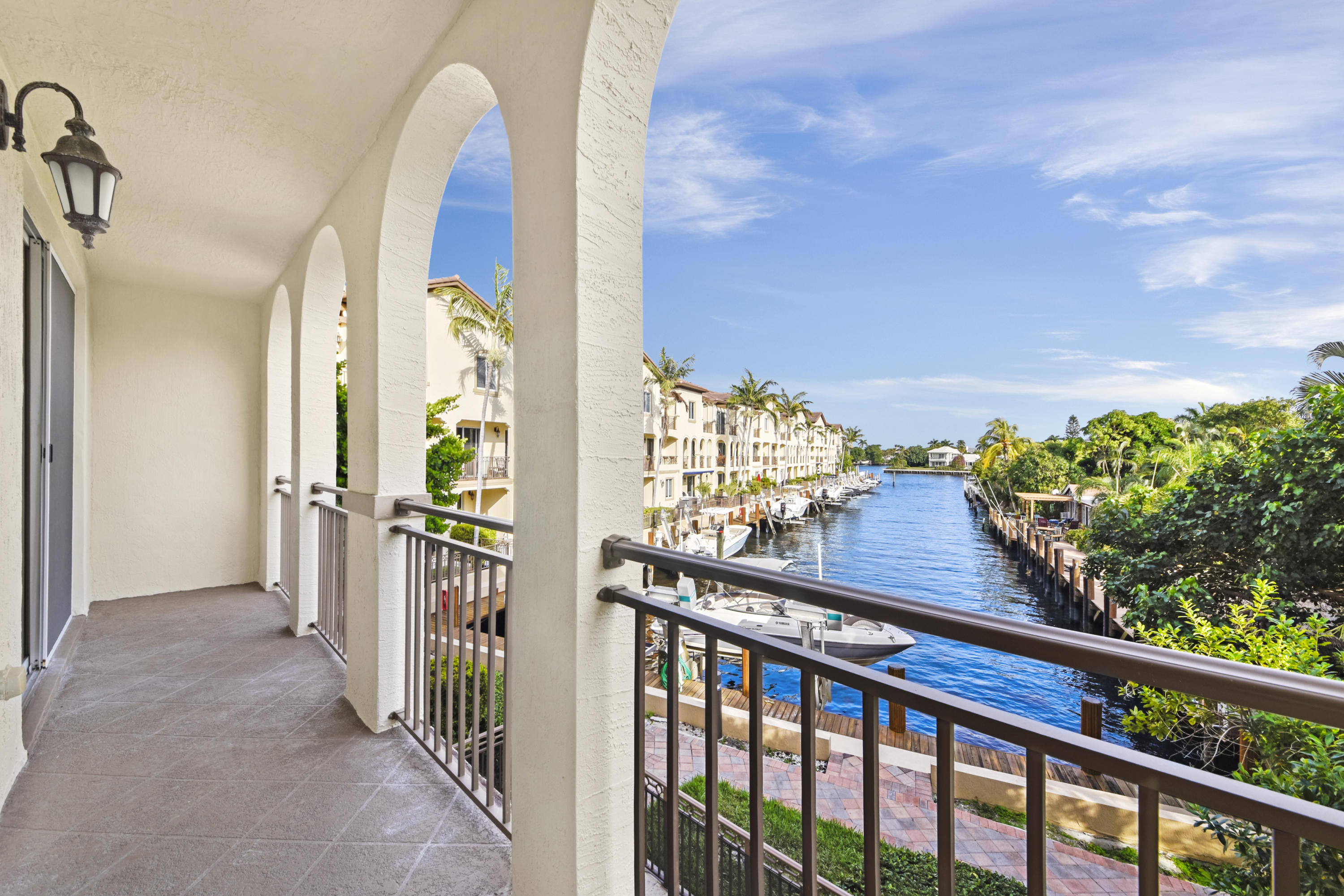 Welcome home to this spacious 3 level, 3 bedroom, 3.5 bathroom townhouse in the intracoastal community of Waterside. All 3 levels have the most amazing waterfront Intracoastal views! This luxury townhouse features beautiful marble flooring with 2 year old hard wood floors in all 3 bedrooms and stairwells, all updated stainless steel appliances, and granite throughout. The main level features a huge living/dining area and kitchen with spectacular Intracoastal views! The 3rd floor features an amazing master suite with huge master closet space and a beautiful balcony overlooking the water. Also on the 3rd floor is bedroom #2 and an additional bathroom. The ground floor level has an entire additional bedroom suite equipped with a full bathroom and an additional living area. Enjoy your evening on 1 of your 3 covered balconies/patios looking out at the beautiful South Florida waterways. The amazing community features beautiful pool and spa with an intracoastal view, clubhouse/community room and exercise room. Owners may have up to 2 pets per HOA and combined weight not to exceed 50 lbs. Boat dock is not included with this property.