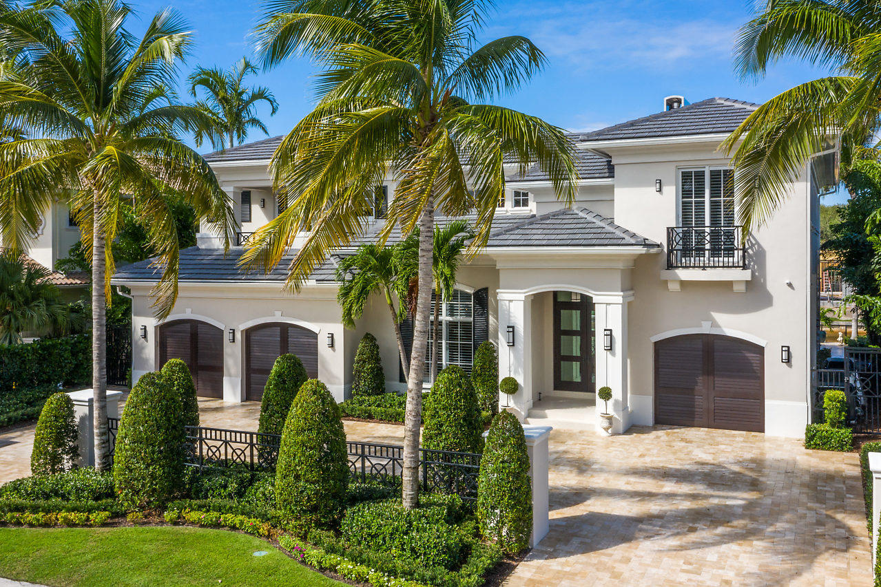 """Spectacular custom construction contemporary, traditional waterfront in the heart of East Boca Raton. Luxuries and fine finishes abound with crown moldings, coffered ceilings and custom mill work. State of the art gourmet kitchen with a white quartzite island, Sub-Zero refrigerator, Wolf 48'' gas range, a Wolf wall oven and microwave, Miele dishwashers and a wine cooler. Open floor plan with a spacious kitchen and family room flowing into the formal living room with a double height ceiling. The second floor master bedroom has breathtaking water views looking north up the length of the canal towards the Intracoastal. 85' water frontage with a brand new 70' yacht dock. Immediate boat access to Lake Boca and the inlet to the ocean. Prime location; walking distance to the beach or Mizner Park. Stunning custom construction waterfront in the heart of East Boca Raton. Luxuries abound in this traditional style home. Only the finest finishings with porcelain and wood floors, crown moldings, coffered ceilings and custom millwork.   State of the art gourmet kitchen with a white quartzite island, Sub-Zero refrigerator and 3' wide freezer, Wolf 48"""" gas range with 6 burners, a griddle and two ovens, Wolf wall oven and microwave, Miele dishwashers and a wine cooler. Completely hurricane proof doors and windows plus a 48 kW Generac whole house generator fueled by city piped propane gas. New hayward pool heater.   Open floor plan with a spacious kitchen and family room flowing into the formal living room with double height ceiling. The second floor master bedroom has stunning views looking North up the length of the canal towards the intracoastal. The waterviews up the canal are unmatched as you gaze across the length of the canal. 85' waterfrontage with a brand new 70' dock. Immediate boat access to Lake Boca and the inlet to the ocean.   Absolutely prime location walking distance to the beach or Mizner Park. Truly paradise!"""