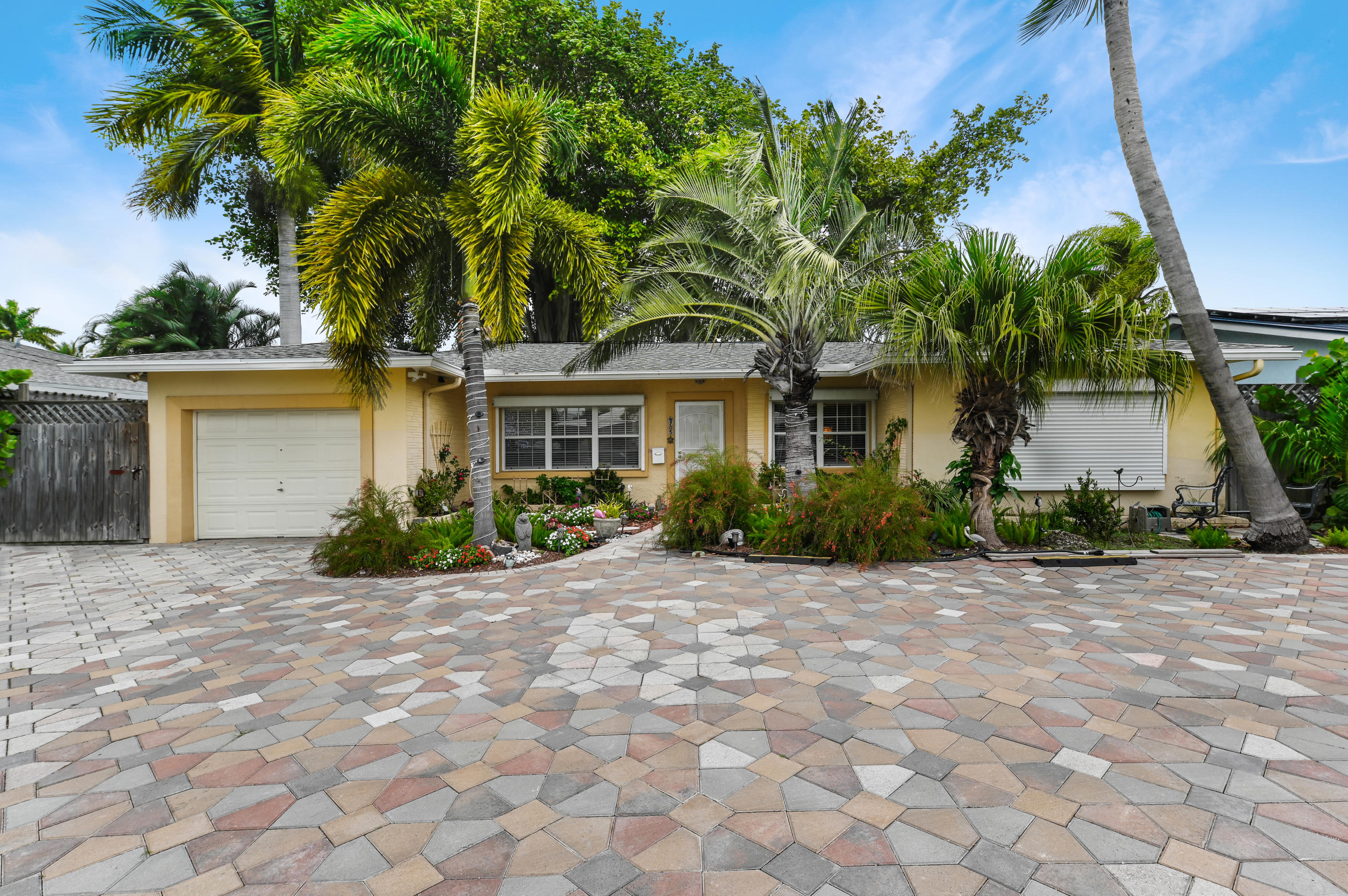 This perfectly situated 3 bedroom, 2 full baths waterfront home sits on a quiet canal just off the Intracoastal Waterway.  You won't need much gas to get to the ocean or the inlet which is less than 700 yards away. Bring your boats and water toys to the brand-new 75' seawall and dock with full water and electric.  Enjoy Deep-Water Ocean Access/No Fixed Bridges, north or south.  Larger boats and yachts are welcome too!  The home has a Rainsoft whole-home water filtration system and 50amp RV hookup.Fishermen and casual boaters alike will love the extreme close proximity to the ocean, waterfront dining, or your choice of Sunday Sandbars, all just minutes away. And the Bahamas are closer than Miami, at a mere 60 miles dock to dock.  Every day is a good day to make the Ocean your backyard.. NO HOA fees, no neighborhood restrictions on boats/RVs/etc.  Just casual South Florida waterfront living at its finest.