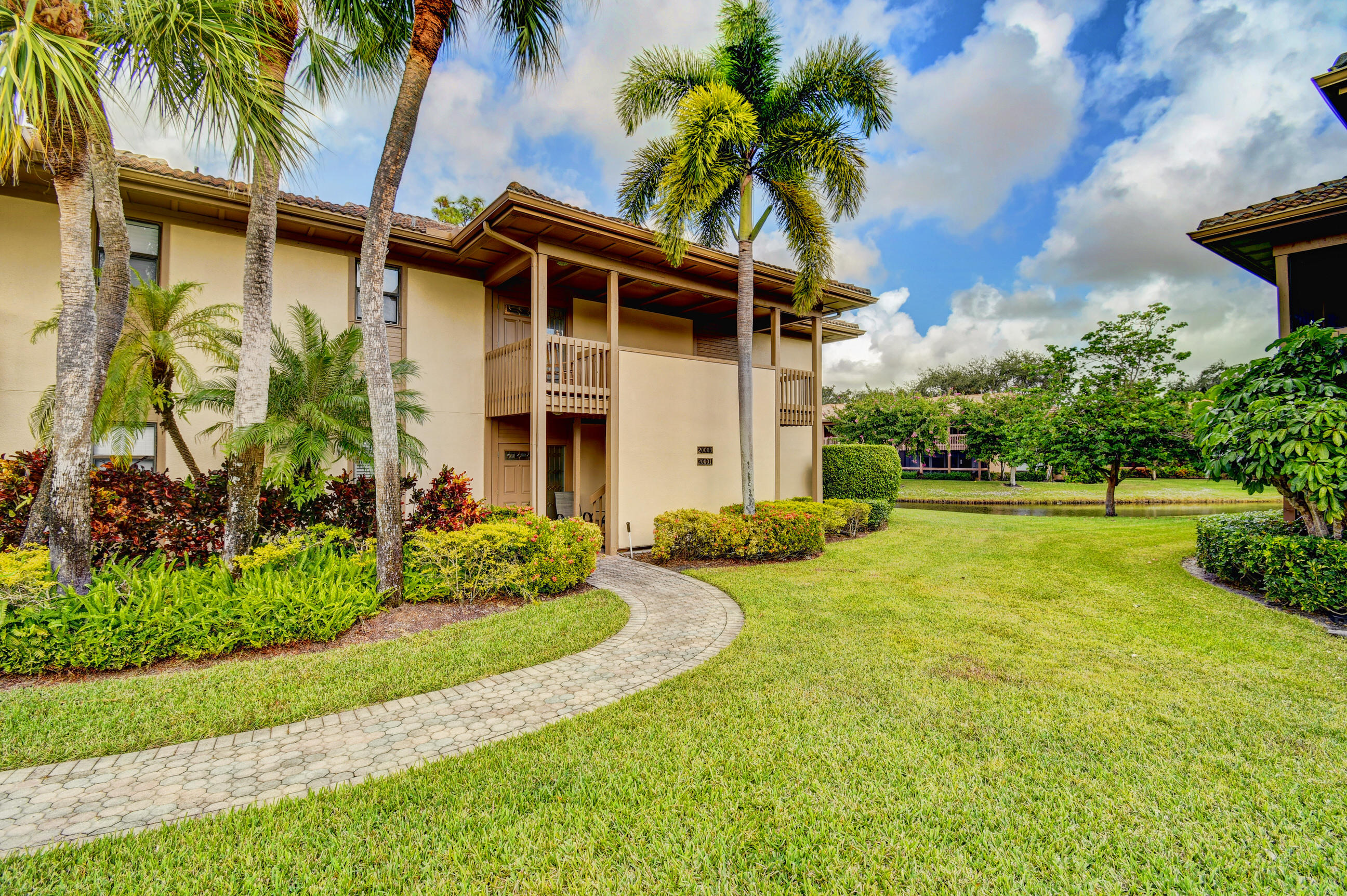 LOVELY 2 BED 2 BATH CONDO WITH FOREVER VIEWS OF GOLF AND WATER. UPDATED FLOORS,NEWER AIR CONDITIONER. GOLF CART PARKING.SIT ON YOUR SCREENED PATIO AND ENJOY THE VIEW AND RELAX.
