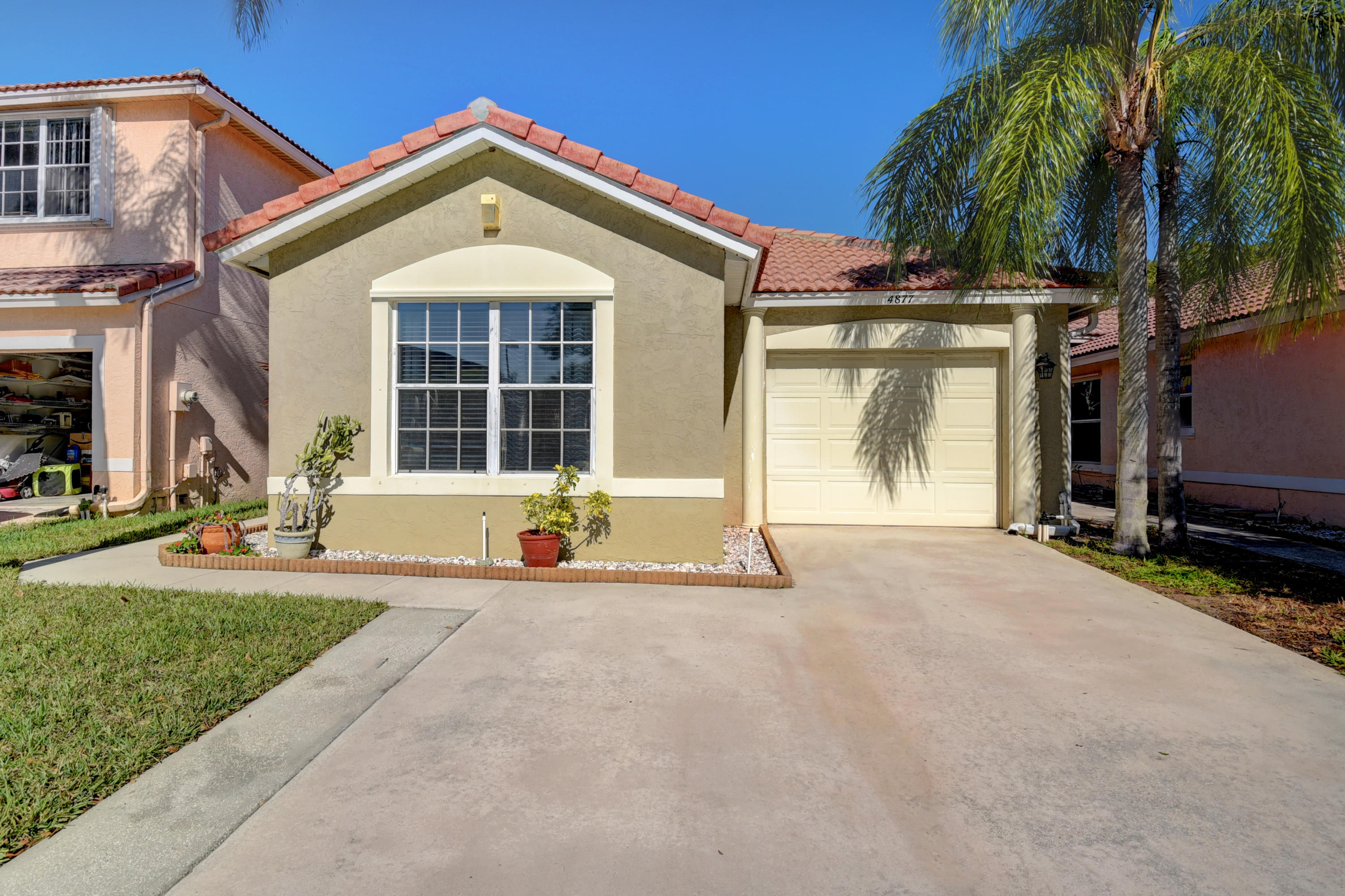 Wonderful 3/2 in the heart of Boynton Beach. This home offers a newer kitchen with white appliances . The home features a screened in patio. There is Laminate wood floors and tile throughout the home. The master bathroom was just recently updated with a new vanity. The large Master Bedroom offers a walk in closet. The community offers a low hoa with a playground and a clubhouse to come soon. It is conveniently located to major highways, schools, restaurant and entertainment.