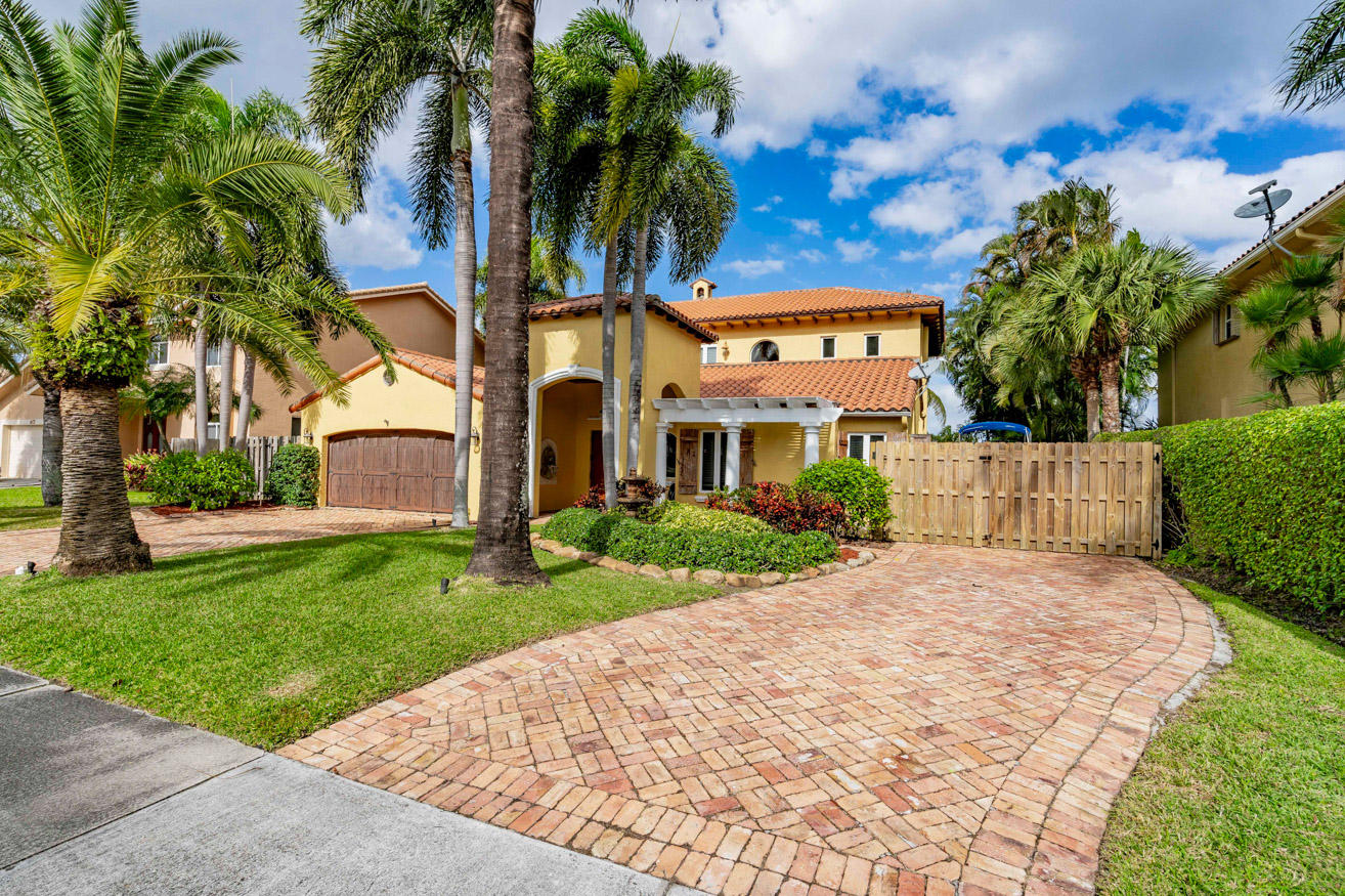 *OPEN HOUSE* SATURDAY 1PM-3PM East Boca dream home! Gourmet kitchen to delight the connoisseur: All Thermador appliances including a 6 burner GAS stove & 2 ovens; SubZero, wine fridge, & ice maker. Backyard paradise-quiet nights snuggling by the fireplace and moonlit waters, or spectacular entertaining in the tiki hut next to the heated natural rock pool and waterfall. Sporty? C15 Lake Ida canal for skiing, fishing, kayaking, dock permitted. Gated boat storage & 2 ICW ramps minutes away. Upstairs is devoted to the private master retreat with f/p, luxe spa bath, closet w island, bonus room w wet bar for office, gym, yoga, + add'l laundry room. 2nd ensuite master bedroom downstairs. Move in ready with high quality finishes, Dade pine PLANK floors, full IMPACT glass. A rated schools. NO HOA.