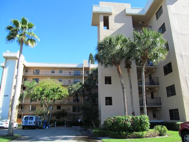 Beautifully maintained, immaculate 2 bdrm condo w/Faux Wood & Ceramic Tile Flooring thru-out. Gently used by Snowbirds.  10k in Upgrades put in! New Roof 2018, Interior Painted 2019, A/C 2017, New Screened Door, New Screens on All Windows & Balcony,, Newer Stainless Steel Refrig, Dishwasher, & Microwave. Secure Storage Unit on same Floor adjacent to Laundry Room. Great Room w/Dining Area & Newer Chandelier, plus Living Rm leading to Tiled, Covered & Screened Balcony offering breathtaking Sunsets Mstr Suite boasts Walk-in Closet, Full Bath w/ walk-in Shower, updated Commode ,Vanity, & Linen Closet. Guest Bdrm adjacent to Full Bath on opposite end of Condo affording Max Privacy for guests. Active Clubhouse w/Resort-Style Amenities. Live the Get-Away Lifestyle!