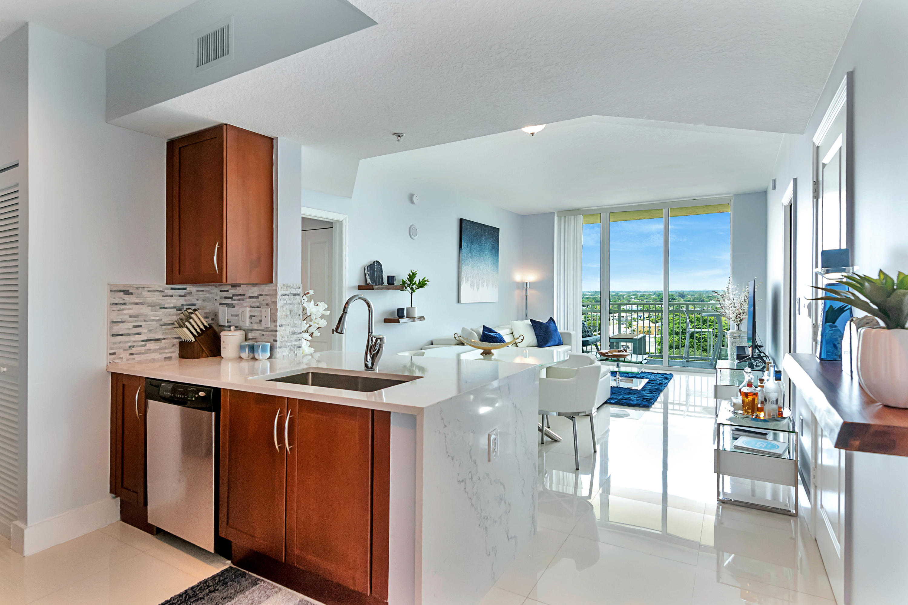Fully furnished turnkey gorgeous 2/2 on the 10th floor updated condo home in resort style Casa Costa Condo Condominium. This condo home features rich porcelain floors throughout the entire apartment. Balcony with north eastern exposure overlooking the city with intracoastal & ocean views. White quartz counter-tops, brand new smooth top range and stainless-steel appliances in the kitchen, washer/dryer, walk-in closets, new TVs, new furniture. This resort style community boasts two pools, fully stocked fitness center, valet parking, sauna, steam room, clubhouse, and much more! Only 1 mile to the beach. Water and sewer, basic cable and high-speed internet (as provided by association) is included. PERFECT PLACE TO ENJOY THE FLORIDA LIFESTYLE!