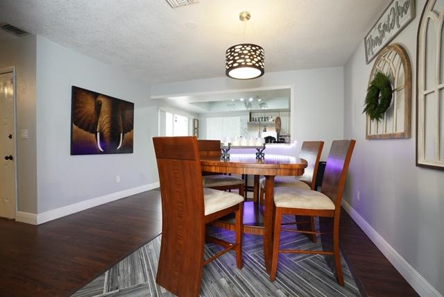 Absolutely gorgeous townhome in the heart of Wellington! Stunning upgrades include a brand new master bathroom, new custom flooring under the dining room table, granite counters, multi-color lighting under the bar, & so much more!!