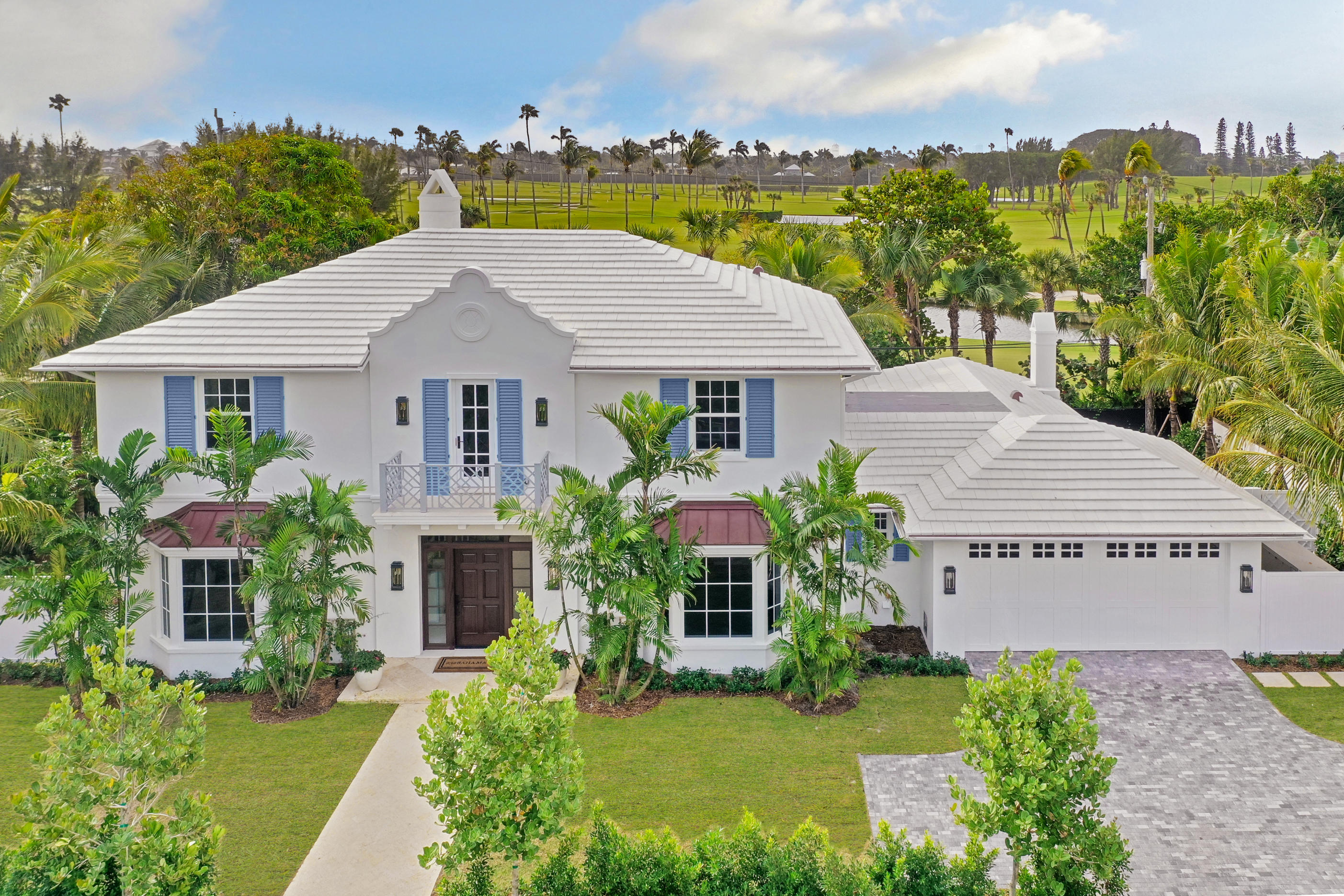Just finished - this is a spectacular custom home designed and built by esteemed  Palm Beach Designer Lisa Erdmann who attended to every detail. Situated on a south facing home site overlooking the PB Country Club golf course and its waterways - breathtaking vistas from both first and second floors with ample privacy and ocean breezes as this home is steps to the beach and the bike trail. Four bedrooms with a large master featuring his and her baths with spacious closets for each. Formal dining - outdoor dining and fireplace with a lap pool along the golf course. This home is NOT the standard PB spec home - it features luxurious marbles, upscale hardwood flooring, quality lighting already installed and generous use of moldings and ceiling treatments. There is no other home with views and features like this brand new custom home offers. See the rest  then come visit this one and you'll agree  no comparison.