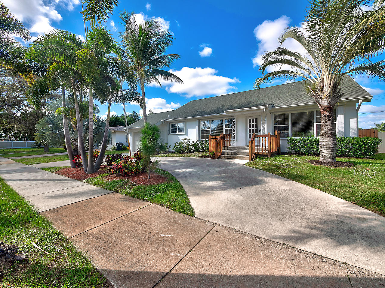 This home features an open light and bright floor plan with vaulted ceilings. It's been freshly painted for your move in and comes with a Brand New Kitchen. This is a great 4 bedroom family home that's located in central Palm Beach County with easy access to I-95. A large fenced in backyard is ready for pets and kids to roam.