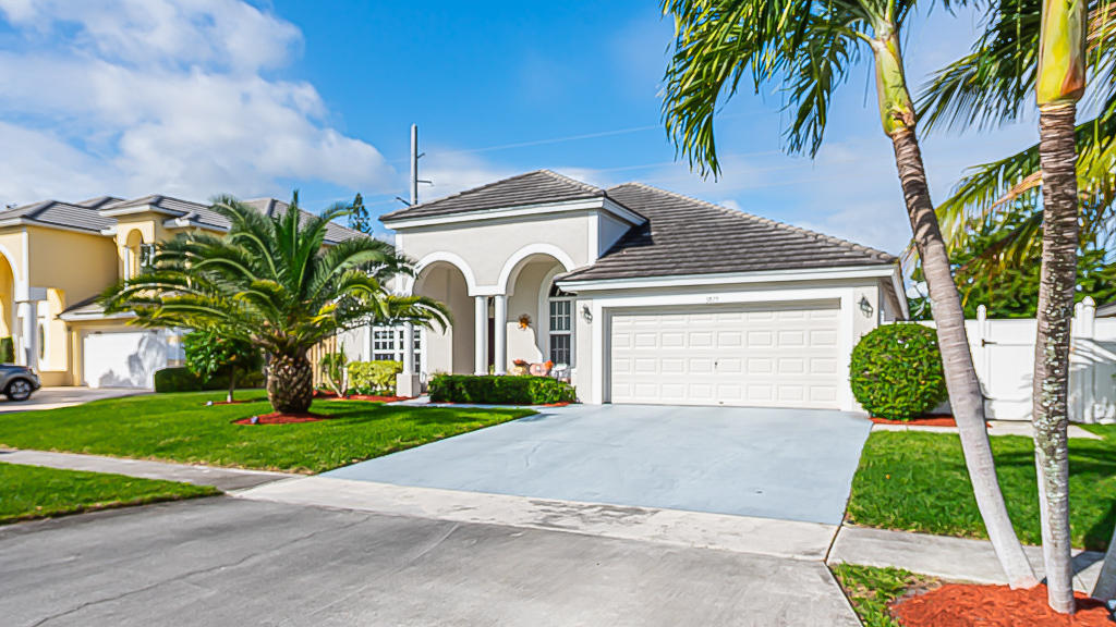 Discover this quaint and quiet small neighborhood in Boynton Beach.  Centrally located, minutes from shopping, restaurants, gym, cafe etc.  No zero lot line.  Homes in this community rarely come on the market.  Priced to sell.Amazingly well kept 3/2 with office that can be used as a 4th bedroom.  Vaulted ceilings.  Open floor plan with a great room.  Stainless steel appliances, granite countertops in kitchen.  Upgraded bathrooms.  Screened patio, large fenced back yard with rock garden and fish pond.  Hurricane impact windows and doors all around.  Portable generator with panel wired.  New water heater in garage.  Washer/Dryer inside in utility room.