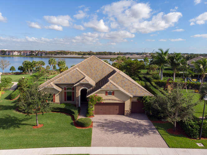 STUNNING 'Ritz' lake front home is truly a unique find w/largest lot available in Castellina! Enter the grand foyer to see impressive views of a private estate property w/salt water pool/spa, lush landscaping, HUGE fully fenced yard & deep lake views. Perfect for entertaining w/ zero-corner sliders out to the pool/patio area seamlessly combining inside/outside living. Listen to the pool/spa fountain & peaceful sounds of the outside while being inside. Hurricane impact windows/doors, sound system, generator, coffered ceiling, wood flrs & new carpet, RH vanity in cabana bath PLUS recently remodeled w/ add'l FB & HB + BR's have been reconfigured to create a private suite for guests. Gated  security /pool/tennis/gym /clubhouse close to shopping/restaurants & 10 minutes to show grounds & barns!