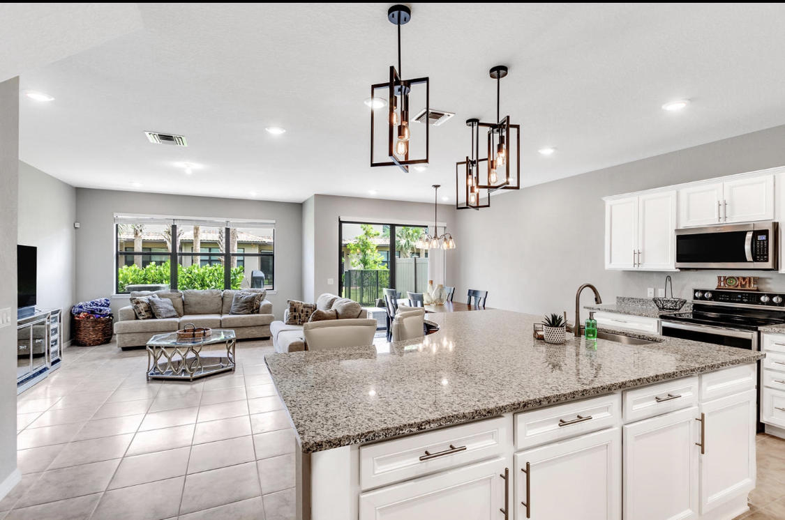 Located in the brand new upscale Divosta Community. This 3/2.5 + loft includes custom upgrades include tile floors, granite countertops, beautiful lighting, ceiling fans, custom cabinetry and impact doors & windows. Wired with smart security system including thermostat, front door & garage door, 3 cameras. Large driveway plus 2 car garage. Gated community includes club house, gym, meeting room, playground & pool. Close to turnpike, Wellington mall, Whole foods, top rated schools and more.
