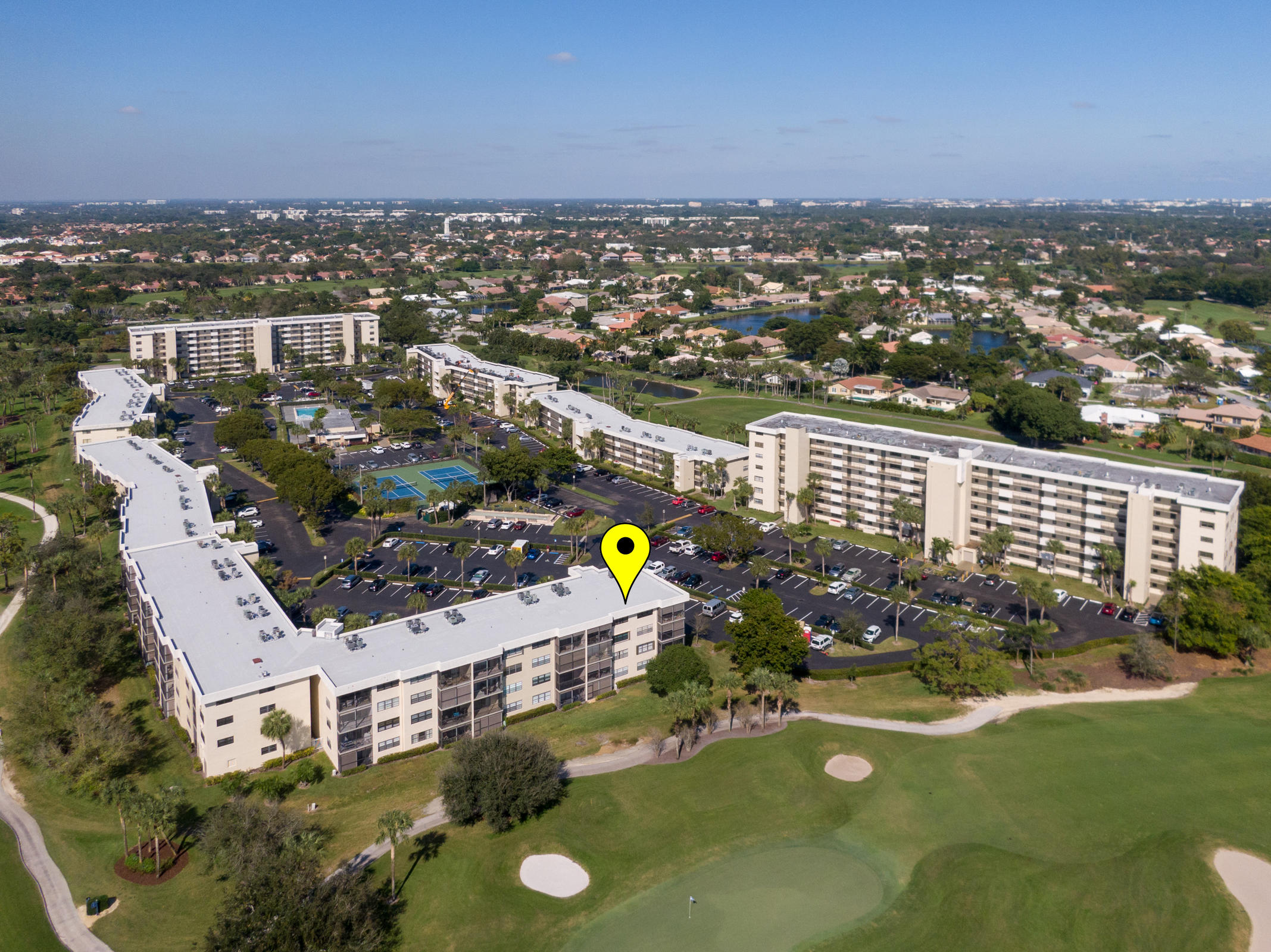 VACANT AND MOVE IN READY! TOTALLY UPDATED FIRST FLOOR CORNER UNIT!! NEW KITCHEN, NEW BATHROOMS,NEW FLOORING, NEW ELECTRICAL PANEL, EXTREMELY LIGHT AND BRIGHT OVERLOOKING THE GOLF COURSE, NO MANDATORY  MEMBERSHIP REQUIRED, ALL AGES, HEATED POOL, TENNIS COURTS, COMMUNITY ROOM, SAUNA AND GYM. ONLY 4 MILES TO DEERFIELD BEACH, CLOSE TO DINING, SHOPPING AND  MORE.