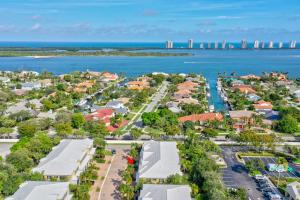 The location doesn't get any better than this Key West Style Townhome in the heart of North Palm Beach