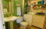 1st floor powder room, newer floors and newer sink with full sized washer and dryer