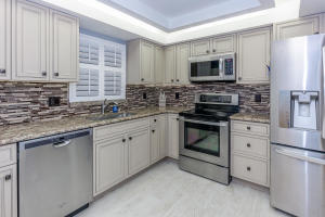 This condo is gorgeous! Check out this kitchen!