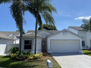 Front view of the home at 2986 Norway Pin Lane, Lantana, FL