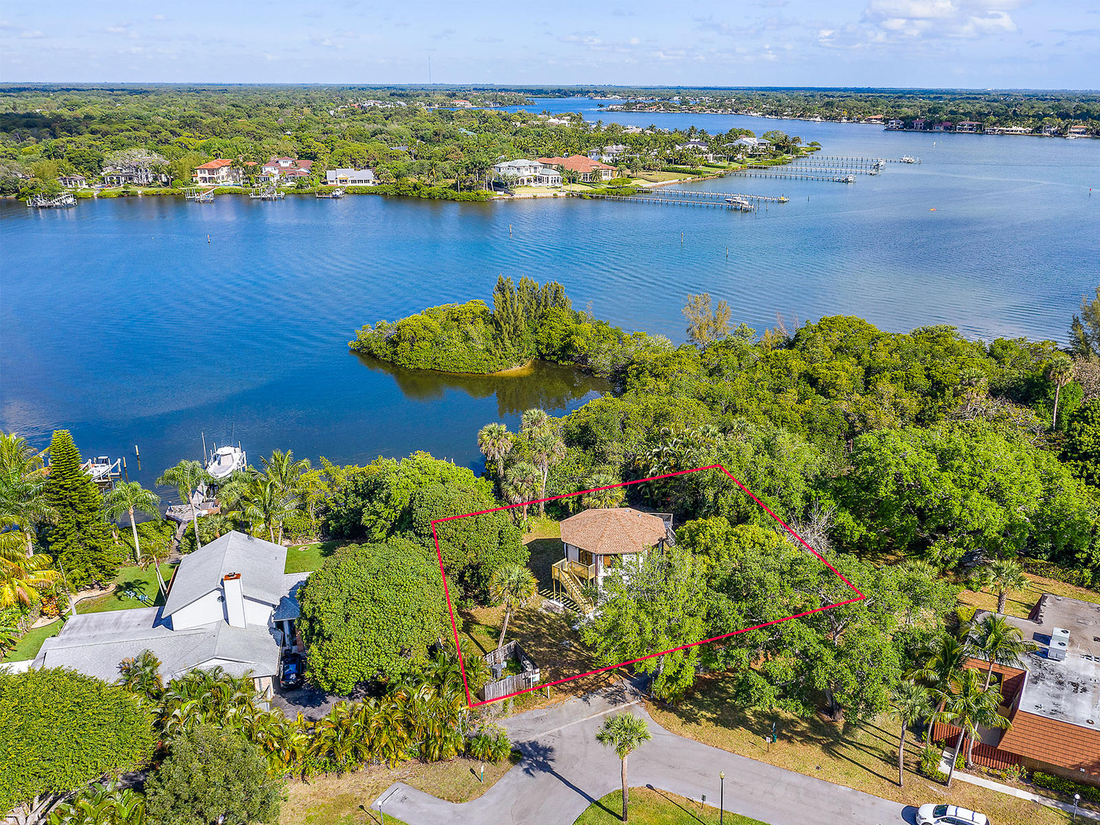 Rarely available waterfront lot on the Loxahatchee River with breathtaking sunset views, wide water views, and secluded cove. Launch your boat, kayak, or wave runner from 100 feet of waterfront with ocean access. Plenty of room to build your dream home. Minutes to the turquoise Atlantic Ocean and inlet for a day of deep water fishing or just a day of relaxation and fun. Conveniently located to I-95, the turnpike, great restaurants, shopping, golf, the Jupiter Inlet, and pristine beaches. Remodel the existing home or build your dream home.