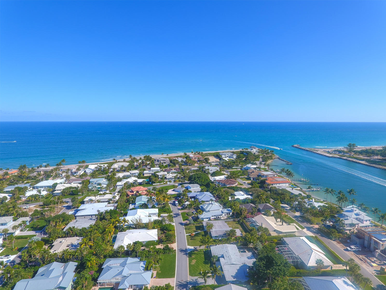 Beautiful beachside community on the South end of Jupiter Island in Jupiter Inlet Colony! 2 Bedrooms, 2 Bathrooms, 1 Car Garage home with a pool! This home features high ceilings, double paned insulated windows, and roof was installed in 2015. The backyard is great for entertaining and has a lush tropical setting with an open patio that overlooks the heated pool. Great home for renovations, addition, or new construction.  Community offers beach access with stunning turquoise, clear ocean waters. This neighborhood is a playground for snorkeling, paddle boarding, fishing and more. Jupiter Inlet Colony is surrounded by the Atlantic Ocean, Intracoastal waters and Jupiter Inlet. Dogs are allowed on the beach with leash. Community is considered its own town with private police department within for the 243 home sites. JIB Club Marina with boat slips and beach club available for additional fees and/or membership required.