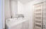 Laundry room with closet