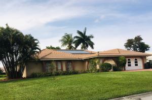 524 Muirfield Drive, Atlantis, FL 33462