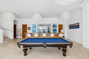 bar and pool table in entertainment room