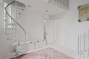 bedroom 1 with spiral stair to loft