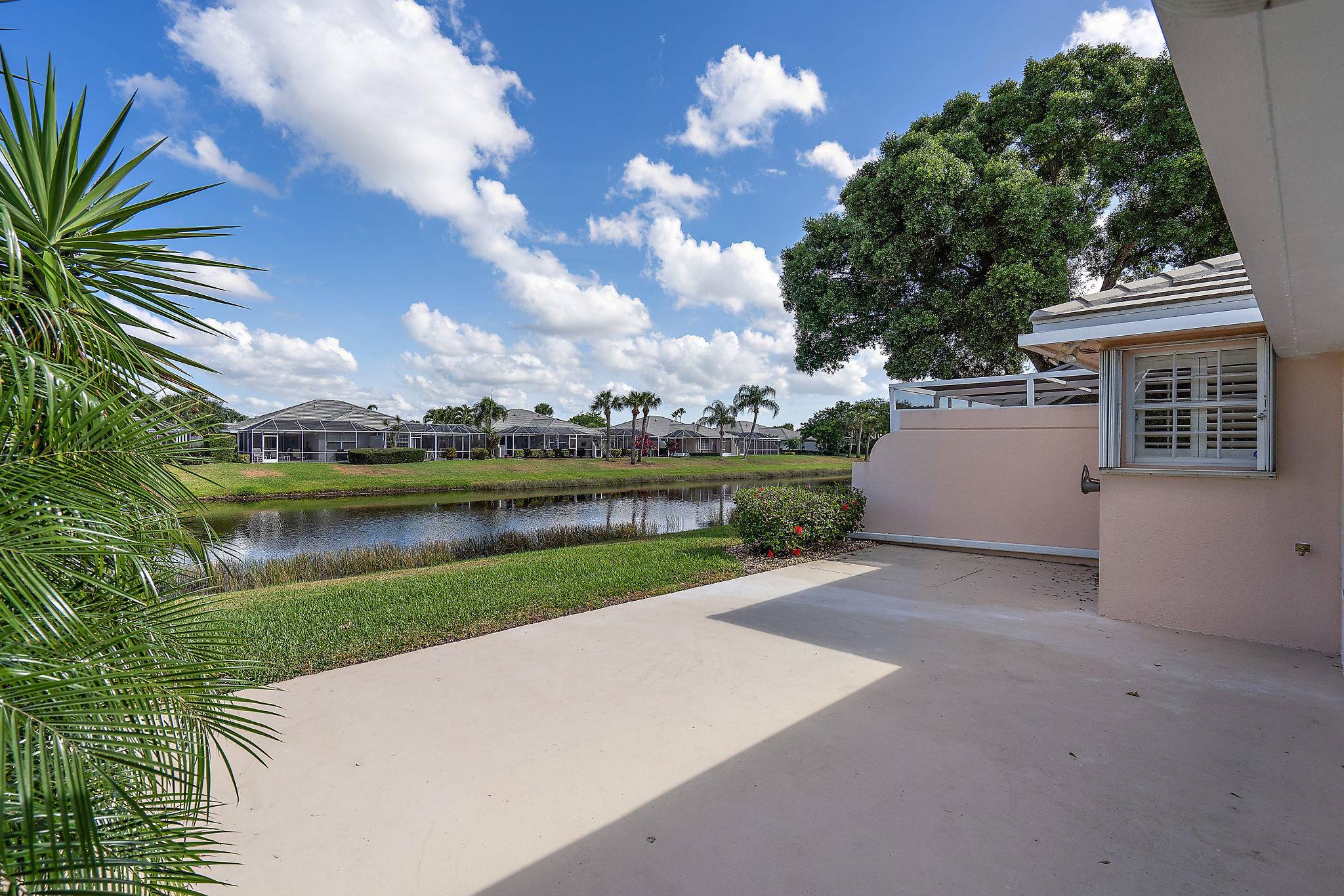 Lakefront Move-In Beauty in a quiet, private community just off St Lucie West Bv & near stadium, shopping & dining! Already passed inspections & ready to go! This DiVosta Extended Capri home is so meticulously maintained it barely looks lived in! In additional, the patio was expanded by previous owners, into a Florida Room which gives this home an extra 200 +/- extra square footage of living space! Two Spacious Master bedrooms w/ custom closet organizers, plantation shutters, granite counters thru-out, entertainment center built in, tons of storage space, indoor laundry room w/ washer, dryer & built-ins & sink, ALL appliances are in perfect condition & included,  Roof maintained by HOA, accordion hurricane shutters & more! PLUS* Pool, tennis and clubhouse a few steps away from this home!