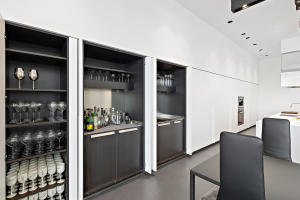 cabinets open to bar