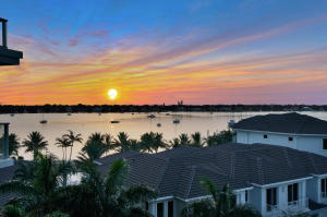 """Desirable """"D"""" """"DeepSky"""" end unit offers tons of light, with both spectacular east and west views over North Palm Beaches """"Lake Worth"""" Intracoastal, exclusive Lost Tree Village, Singer Island, and MacArthur Beach / State Park"""