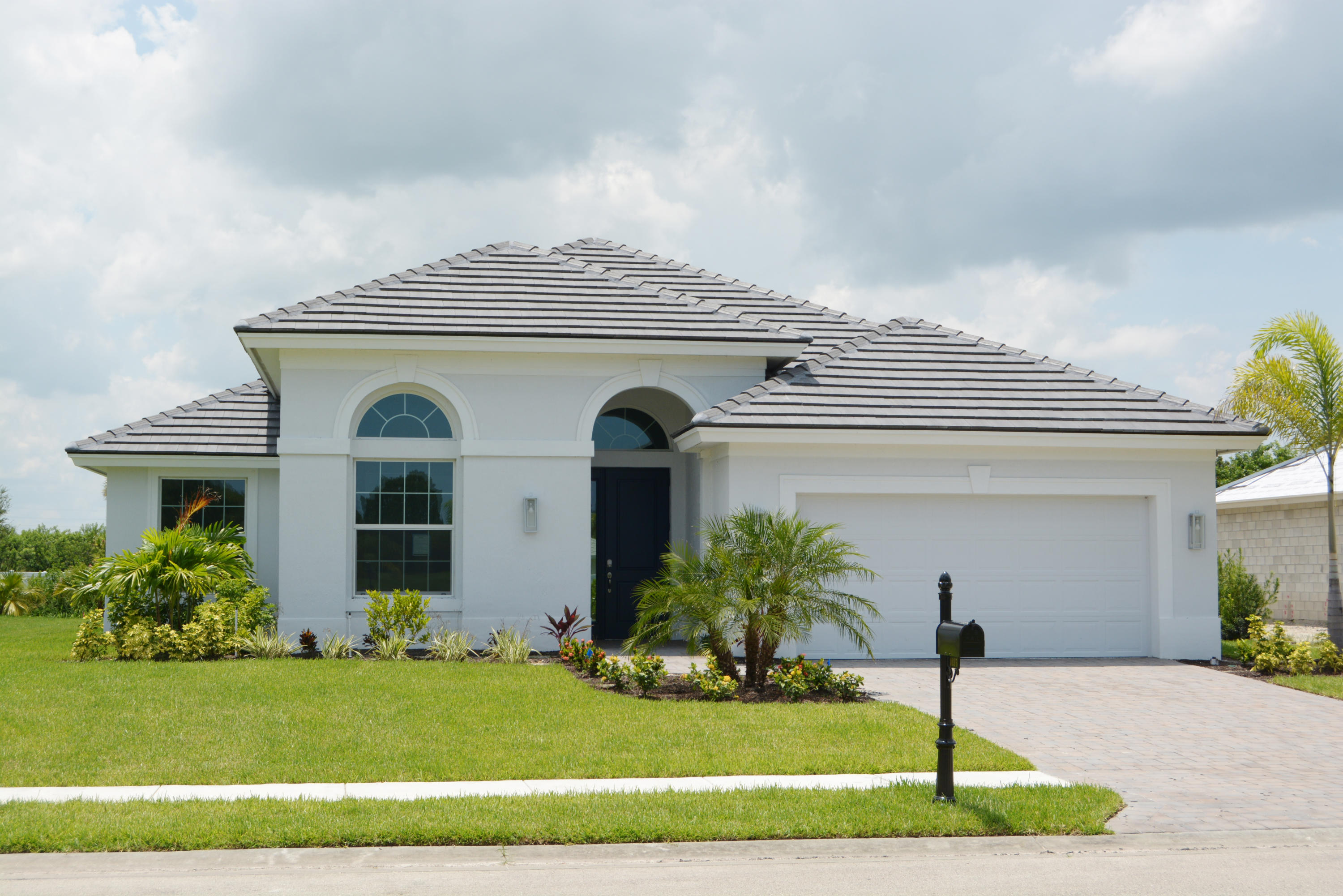 This GHO Homes model is ready to move in NOW! Beautiful Lisbon - 2 BR + Den, 2.5 Baths, Workshop in Garage! Tile throughout! Upgraded stainless steel kitchen appliances, double oven w/convection & fan hood, French door refrigerator dishwasher, Subway tile backsplash & island! Wooded & private lot!