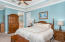 Bright spacious and elegant owners suite with walk in closet,crown molding and trey ceilings
