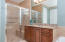 Linger in your glass shower complete with tile bench and safety handles