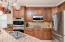 Stainless appliances and copper style backslash, under cabinet lighting, pantry ,double ovens and more