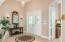 Front formal open living room foyer.vaulted ceilings and elegance greet you