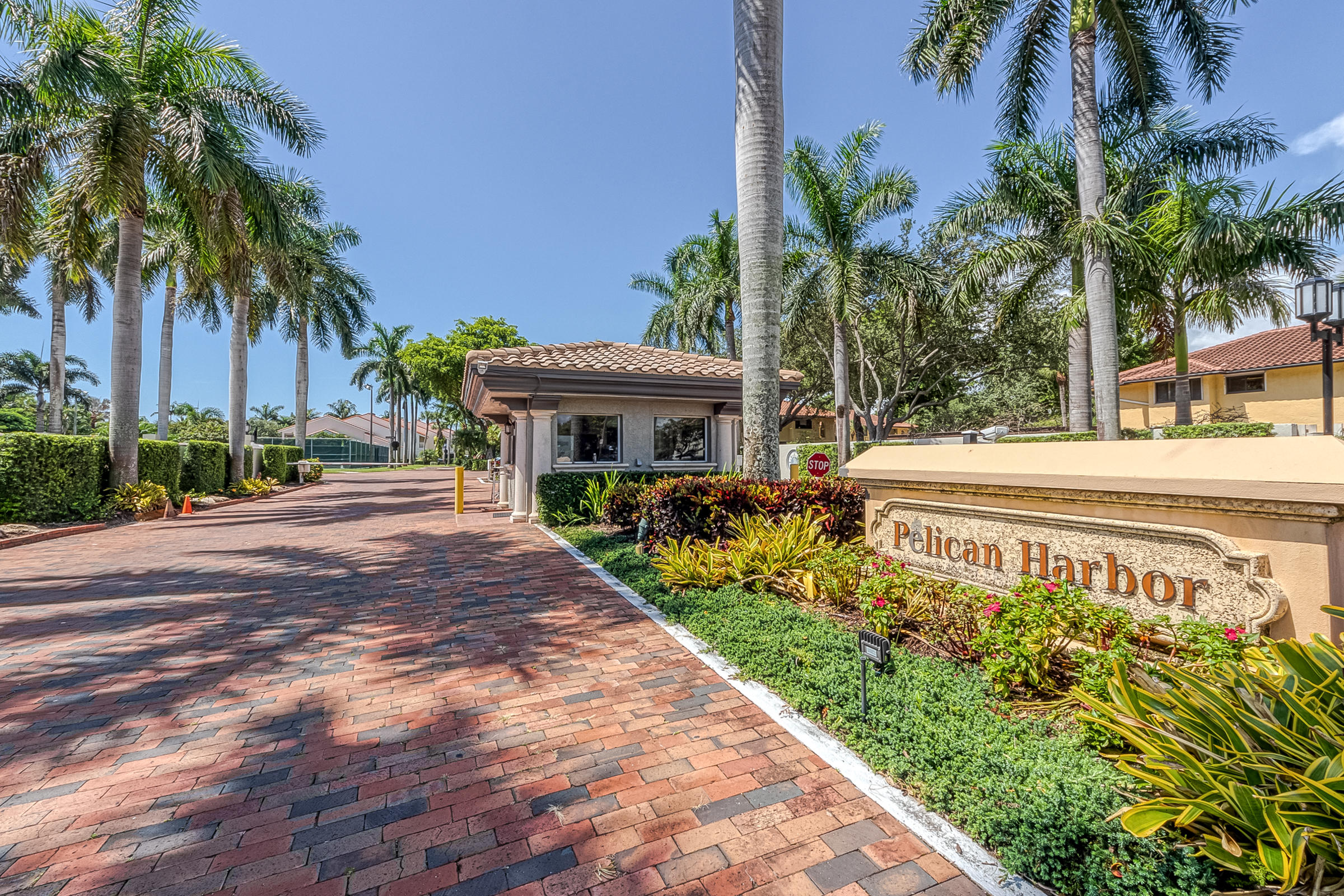 2 BR/2BA condo in Pelican Pointe, one of Delray Beach's most sought after waterfront communities This unit features an eat in kitchen, no carpet, plantation shutters & newer a/c and water heater. Sliding doors in the living room & master bedroom lead out to a lg screened patio facing north. Patio also has a storage closet. Lg master bdrm has two closets, one is a walk in.  Master bath has dual sinks & a roman tub..Accordion shutters on all windows & on patio. Pelican Pointe is a pet friendly & all ages community.  You can take a short walk to the intracoastal & feel secure with a  24 hr manned guard gate. Assigned, covered parking spot.  Dock space is available for sale or lease. Heated pool & tennis courts.  Minutes away is Trader Joe's an
