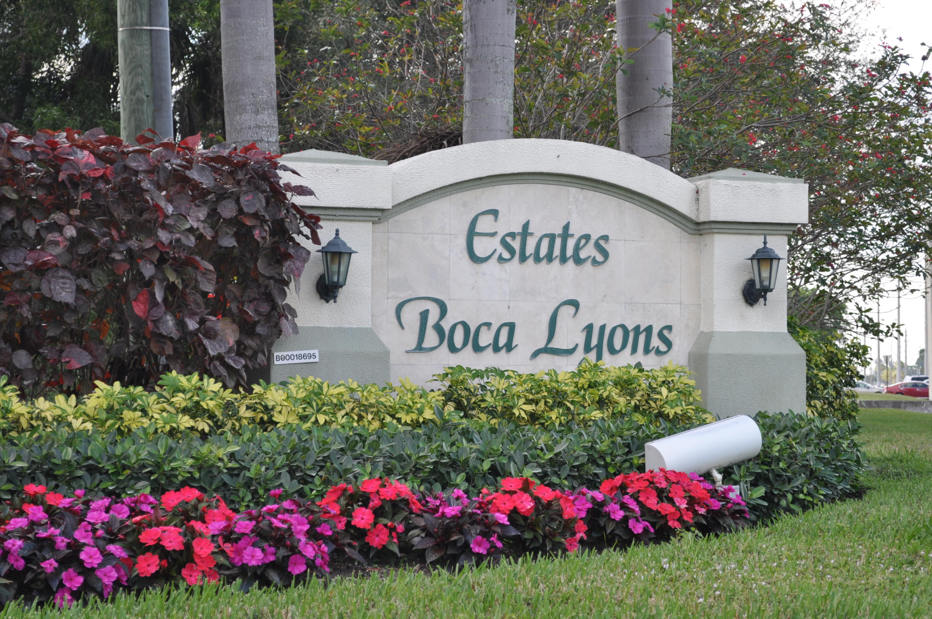 4 bedrooms, 2 1/2 bath, pool home in the desirable Estates of Boca Lyons, ''Bocas hidden secret''. Oversized 2 car garage.Spacious floor plan incl. a wood burning fireplace. Many updates incl kitchen w/ SS appliances, all bathrms, ceramic tile throughout. Lg laundry rm under A/C w/ tub &  2nd refrig. Inviting screened pool w/ travertine deck & patio..Pool is heated & a new child pool gate installed last yr.  2 A/C units, both 6 yrs. w/ Halo system. Yard is completely fenced w/ newer white poly fencing. Outside storage shed. Accordian shutters on all openings & hurricane rated garage door.Front of home has been restoned & beautifully landscaped. Sprinklers on well/pump & timer. Roof replaced in 2003. HOA is $100 a qtr. No appl/interview..Kid