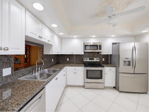 light and bright kitchen with white cabinets